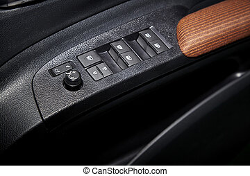 Car window controls and details - Car interior details of...