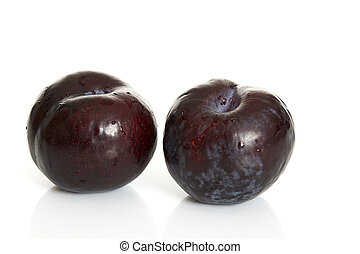 black plums - two black plums, isolated on white background
