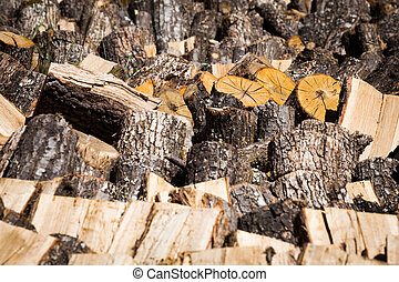 Dried logs on a wood pile for winter fuel