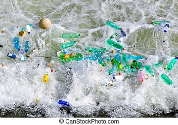 Environment waste - Plastic bottles waste in polluted water...