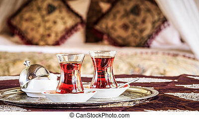 Two turkish tea cups and turkish delight with oriental...