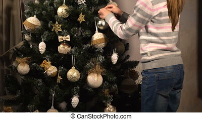 Teen girl decorate chrismas tree - Teen girl decorate beauty...