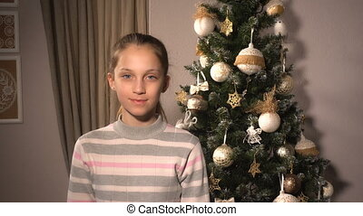 Teenager funny girl with mask of Santa