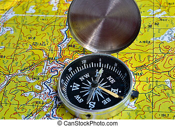 Map with compass. Necessary navigational tools, they will...