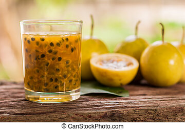 Passion fruit - Passion fruits half and juice with leaves on...