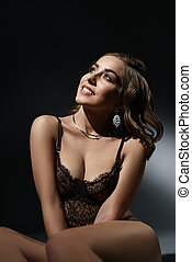 Young sexy woman posing in black lace lingerie