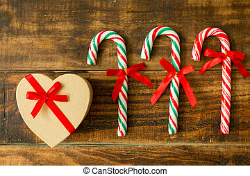 Present for Christmas and Candy Canes with ribbon