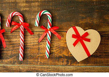 Present for Christmas and Candy Canes with ribbon on a...