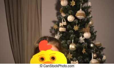 Teen girl with christmas props mask of chicken - Teen girl...