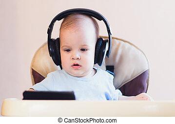 little kid watching a cartoon on the phone - child listening...