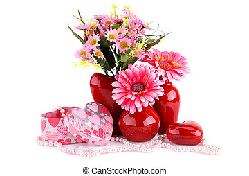 Flowers in vases, red heart glass, necklaces, gift boxes...