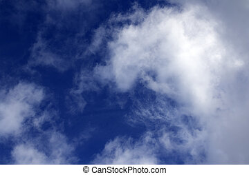 Blue sky with sunlight clouds in evening. Natural...