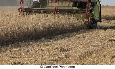 Harvesting agricultural combine machine with reel and cutter...