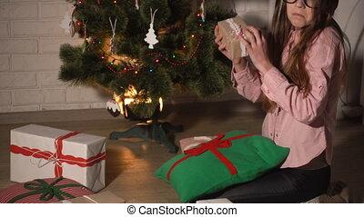 Teenager girl checking gift boxes