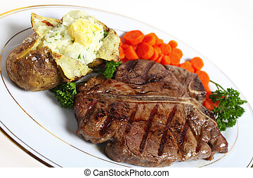 T-bone steak dinner - A dinner of a T-bone or porterhouse...