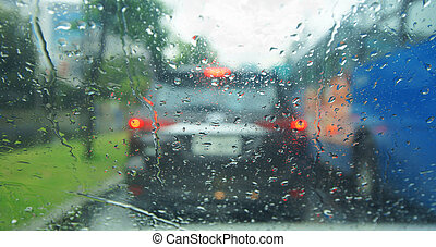 View of traffic on the street during a rain from the inside...