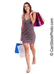 Shopping time - Beautiful young girl carrying shoping bags...
