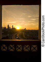 beautiful sunset view in kuala lumpur city from a window