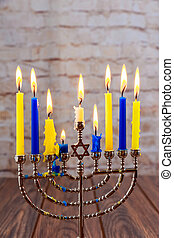 jewish holiday Hanukkah with menorah over wooden background...