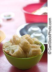 'Yau Char Kuai' (literally translated to 'Oil Fried Ghost'), a crispy fried flour Malaysian snack