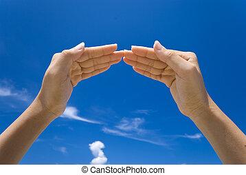 hand symbolizing house