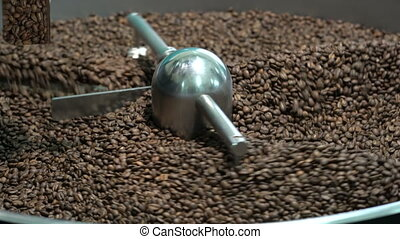 roasted coffee beans in a coffee roaster - Freshly roasted...