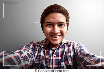 Man selfie on camera