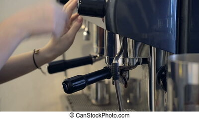 Professional coffee machine making cappuccino in a cafe