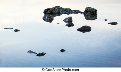 Stones in the water on the lake