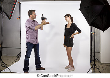 Photographer Demonstrating Photoshoot - Photographer in a...