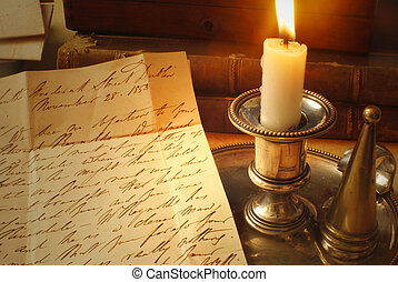 Old letter and candle, elegant handwriting