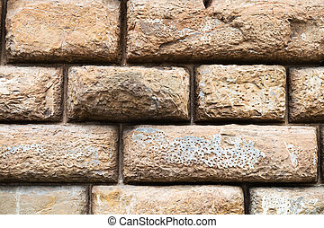 rows of brown blocks in wall of Palazzo Pitti - travel to...