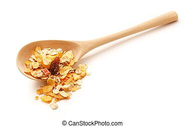 Heap of musli with raisin in wooden spoon - Heap of fresh...