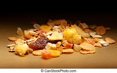 Heap of fresh musli with raisin on paper background