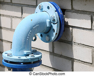 Blue pipe line - Blue painted pipe on the white bricks wall
