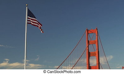 US American Flag Waving Golden Gate Bridge National...