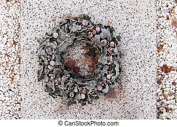funeral wreath decorated with leaves and nuts covered with...