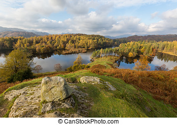 Rocky viewpoint overlooking Tarn Hows in The Lake District, UK