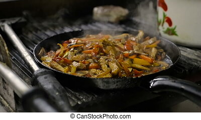 Cooking vegetables and chicken breast fillet in pan -...