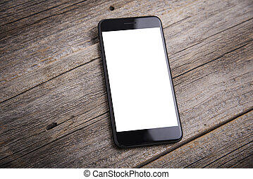 Smartphones on wooden background. - Mobile smartphone on a...