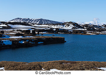 Myvatn volcano over blue lagoon, winter natural landscape,...