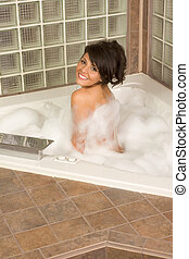 Attractive young gorges woman taking Bubble bath - bathtub...