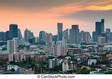 Bangkok city office building business downtown during sunset, Thailand