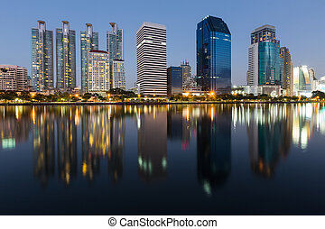 City office building with reflection over water lake