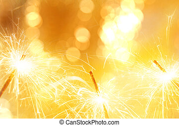 Gold light sparkler with bokeh de focused blurred...