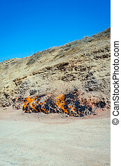 Flaming mountain, Baku, Azerbaijan - Burning rocks at...