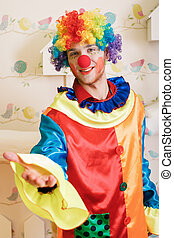 Clown offers friendship. - Happy clown with red nose and...