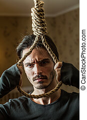 Desperate businessman preparing to commit suicide. Depressed...