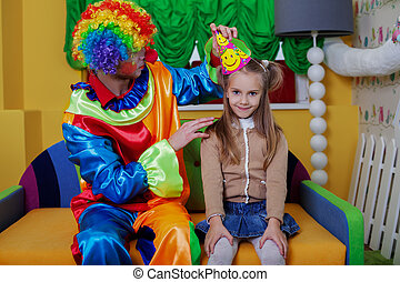 Little girl has put on a cap. - Little girl has put on a...