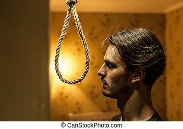 Desperate man preparing to commit suicide. Depressed man...